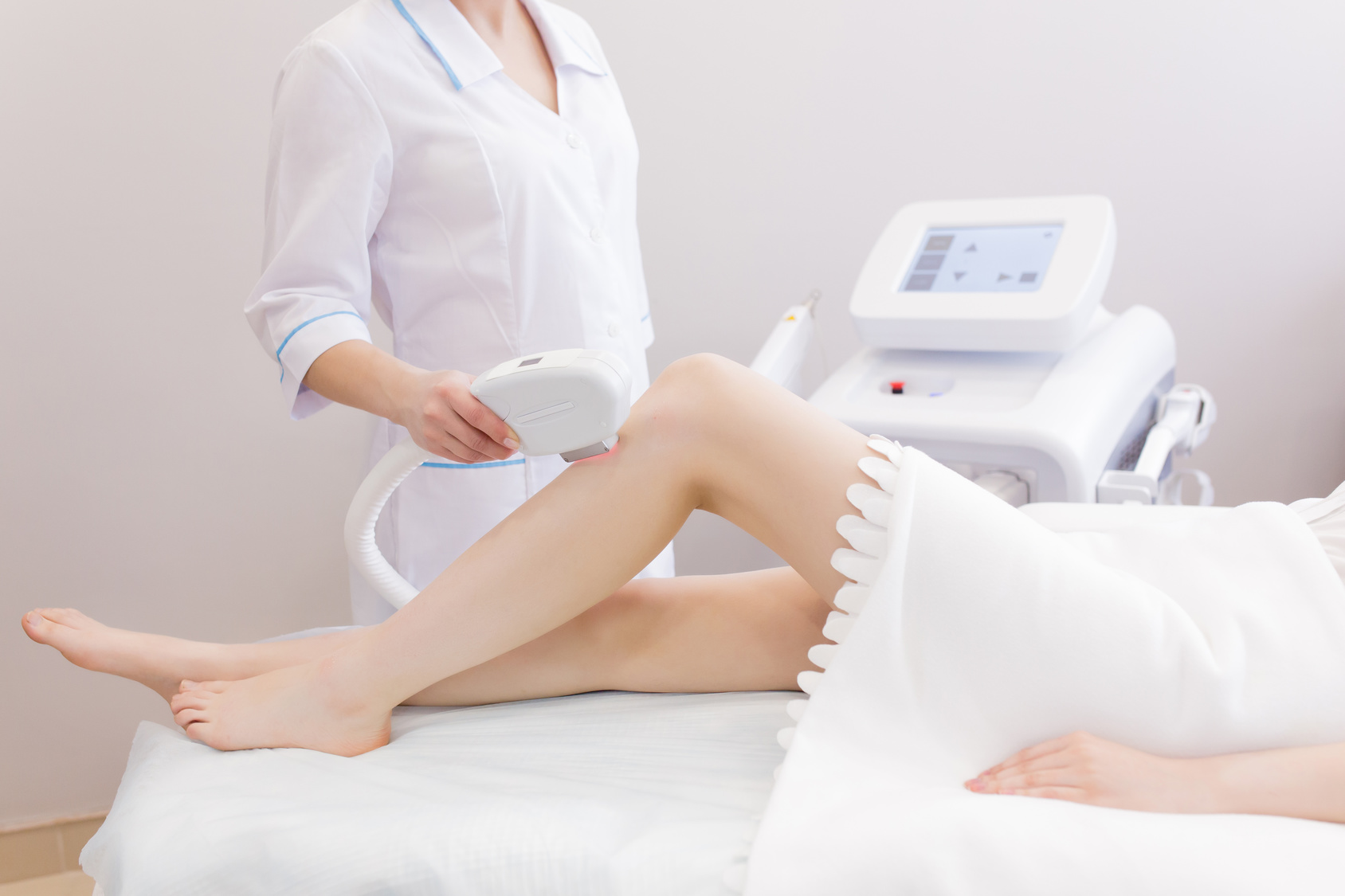 Woman on laser hair removal procedure at beauty salon
